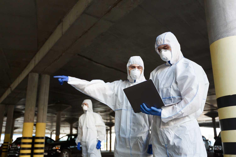 nvto_elmnt-men-in-special-virus-protective-suits-making-resea-DF3CXFQ